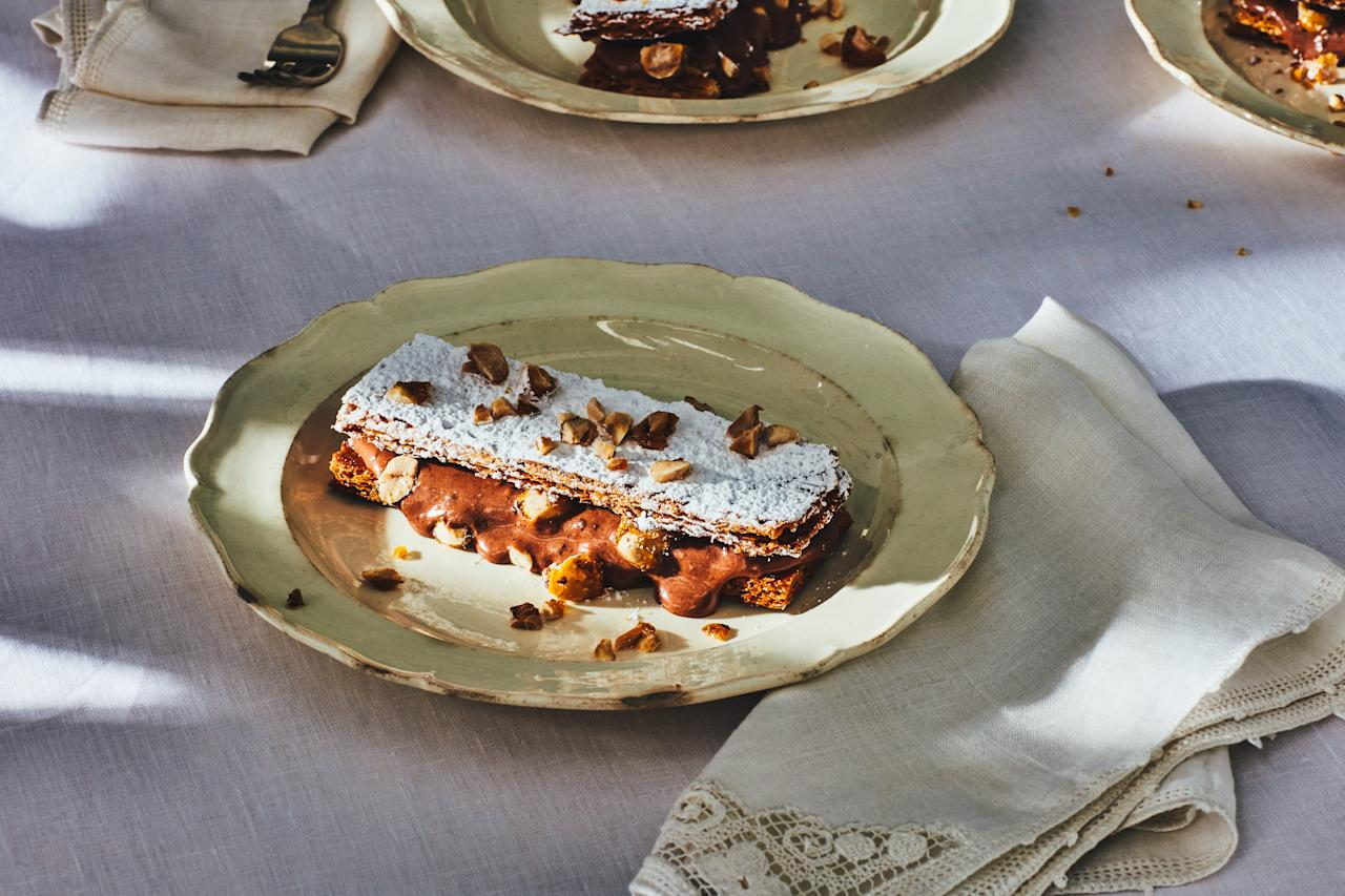 """All of the elements for this elegant dessert can be prepped at least two days ahead. This recipe was part of <em>Gourmet</em>'s unpublished <a href=""""https://www.epicurious.com/holidays-events/lost-christmas-recipes-of-gourmet-magazine-article?mbid=synd_yahoo_rss"""">final Christmas menu</a>. <a href=""""https://www.epicurious.com/recipes/food/views/chocolate-hazelnut-napoleons?mbid=synd_yahoo_rss"""">See recipe.</a>"""
