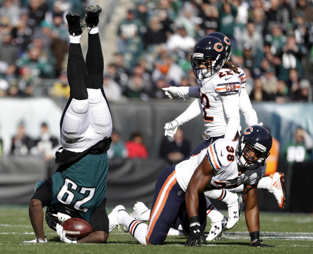 <p>Philadelphia Eagles' LeGarrette Blount (29) is upended by Chicago Bears' Adrian Amos (38) during the first half of an NFL football game, Sunday, Nov. 26, 2017, in Philadelphia. (AP Photo/Michael Perez) </p>