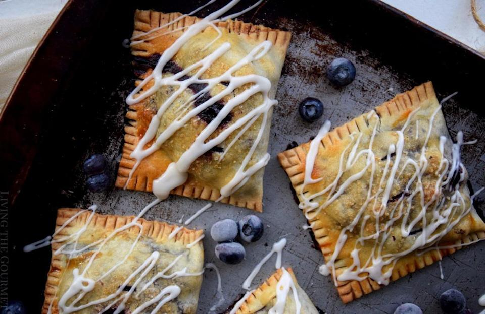 """<p>Join the blue(berry) wave and try this hand pie recipe bursting with fresh flavors of some of the <a href=""""https://www.thedailymeal.com/most-iconic-pie-every-state-gallery?referrer=yahoo&category=beauty_food&include_utm=1&utm_medium=referral&utm_source=yahoo&utm_campaign=feed"""" rel=""""nofollow noopener"""" target=""""_blank"""" data-ylk=""""slk:best pies"""" class=""""link rapid-noclick-resp"""">best pies</a> you've ever had.</p> <p><a href=""""https://www.thedailymeal.com/recipes/blueberry-basil-hand-pies-recipe?referrer=yahoo&category=beauty_food&include_utm=1&utm_medium=referral&utm_source=yahoo&utm_campaign=feed"""" rel=""""nofollow noopener"""" target=""""_blank"""" data-ylk=""""slk:For the Blueberry Basil Hand Pies recipe, click here."""" class=""""link rapid-noclick-resp"""">For the Blueberry Basil Hand Pies recipe, click here.</a></p>"""