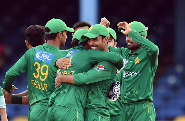 Pakistan's Shadab Khan (R) embraces team Pakistan's captain/wicketkeeper Sarfraz Ahmed as they celebrate their victory at the end of the second of four-T20I-match between West Indies and Pakistan March 30, 2017 (AFP Photo/Jewel SAMAD)