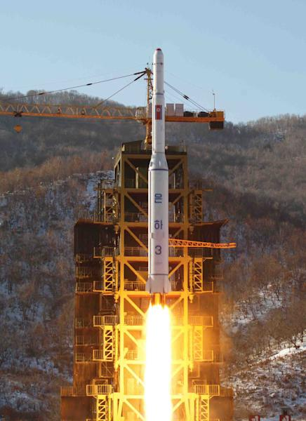 FILE - In this Dec. 12, 2012 file photo released by Korean Central News Agency, North Korea's Unha-3 rocket lifts off from the Sohae launch pad in Tongchang-ri, North Korea. The Cold War still rages in North Korea, and enemy No. 1 is the United States, which Pyongyang blames for making necessary its much-condemned drive to build nuclear weapons. A rich vein of propaganda, fueled by decades-old American threats, holds that North Korea remains at risk of an unprovoked nuclear attack, though Washington and others say brinksmanship is the North's true motive. (AP Photo/KCNA, File)