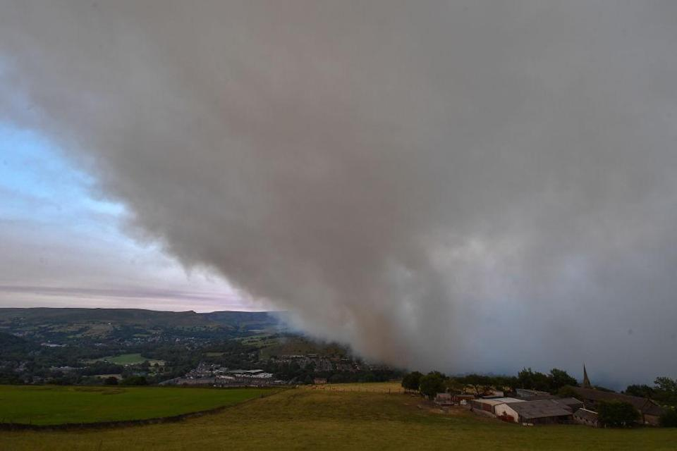 A large cloud of smoke covers the village of Mossley (Picture: Getty)
