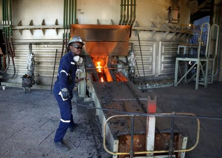 FILE PHOTO: A worker attends to machinery at a smelter plant at Anglo American Platinum's Unki mine in Shurugwi