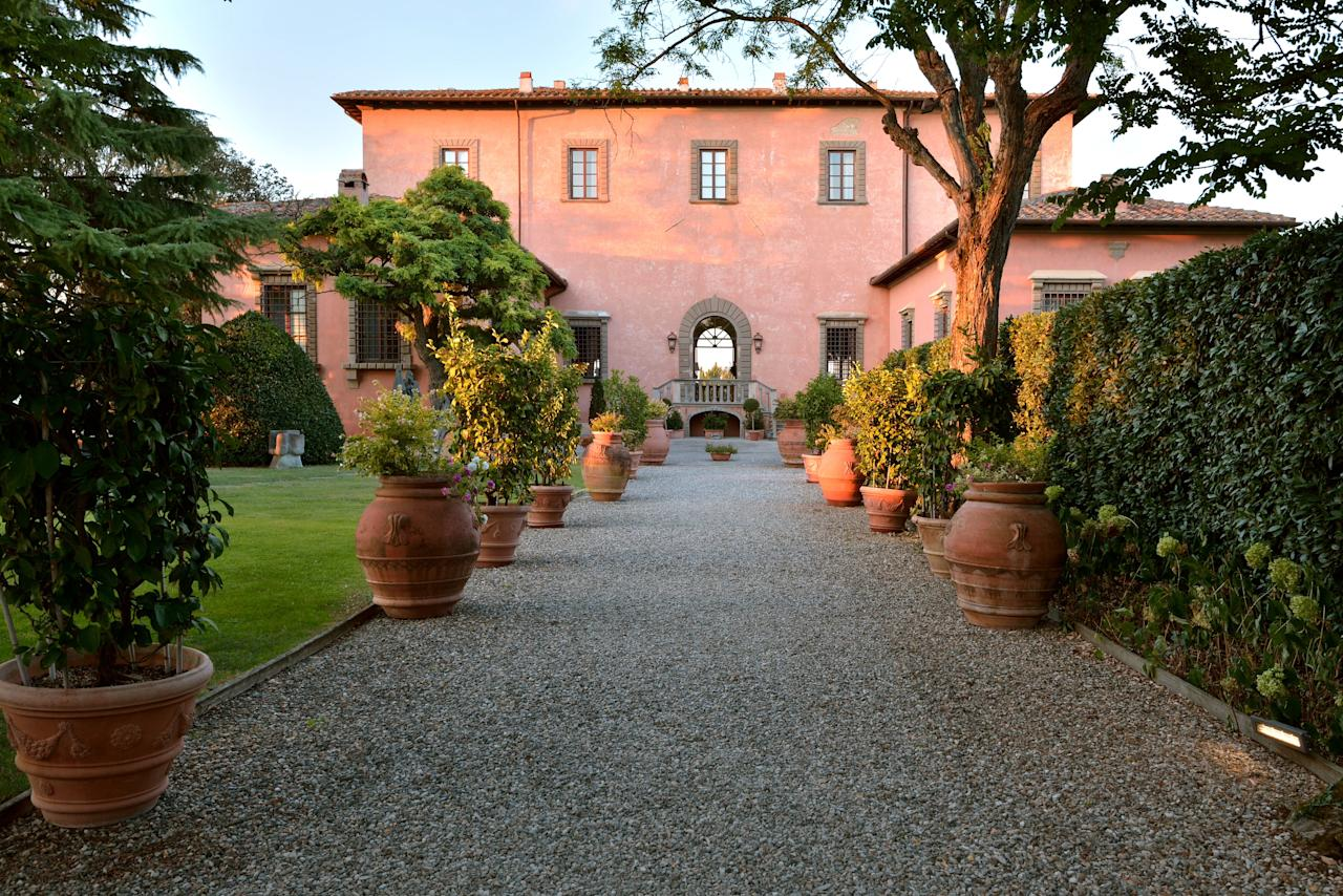"""In the hills just south of <a href=""""https://www.cntraveler.com/destinations/florence?mbid=synd_yahoo_rss"""" target=""""_blank"""">Florence</a>, Villa Mangiacane has an enviable view of the city. The scenery inside is just as nice. Built in the 15th century by the Machiavelli family, it bears the unmistakable hand of one of the Renaissance's greatest masters, Michelangelo. It now consists of Palazzo Machiavelli, a ten-suite palace for one group of up to 22 people, and Villa Mazzei, which has 18 rooms and suites that can be booked individually. Art and history are a big deal here, and the hotel's collection includes centuries-old frescoes, Shona sculptures from Zimbabwe, and a multitude of other pieces from Italy, Africa, and India (an homage to the multicultural staff). The setting, amid 600 acres of vineyards and olive groves, also allows for on-site tastings of wine and oil."""