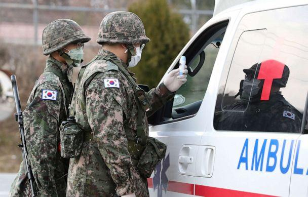 PHOTO: South Korean soldiers wearing masks to prevent contracting the novel coronavirus stand guard at a checkpoint of a military base in Daegu, South Korea, Feb. 26, 2020. (Stringer/Reuters)