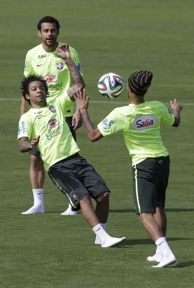 Brazil's Neymar, right, Marcelo, center, and Fred, top, practice during a training session at the Granja Comary training center in Teresopolis, Brazil, Saturday, June 14, 2014. Brazil plays in group A at the 2014 soccer World Cup. (AP Photo/Andre Penner)