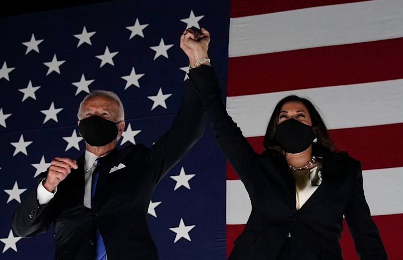 Former vice-president and Democratic presidential nominee Joe Biden (L) and Senator from California and Democratic vice presidential nominee Kamala Harris greet supporters outside the Chase Center in Wilmington, Delaware, at the conclusion of the Democratic National Convention, held virtually amid the novel coronavirus pandemic, on August 20, 2020. (Photo by Olivier DOULIERY / AFP) (Photo by OLIVIER DOULIERY/AFP via Getty Images)