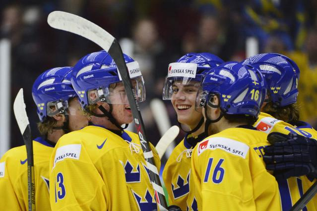 Sweden's Andre Burakowsky (C) celebrates with teammates Gustav Olofsson (13) and Filip Forsberg (16) after scoring against Norway during their IIHF World Junior Championship Group B preliminary round ice hockey match at Malmo Arena in Malmo, December 29, 2013. REUTERS/Ludvig Thunman/TT News Agency (SWEDEN - Tags: SPORT ICE HOCKEY) ATTENTION EDITORS - THIS IMAGE HAS BEEN SUPPLIED BY A THIRD PARTY. IT IS DISTRIBUTED, EXACTLY AS RECEIVED BY REUTERS, AS A SERVICE TO CLIENTS. SWEDEN OUT. NO COMMERCIAL OR EDITORIAL SALES IN SWEDEN. NO COMMERCIAL SALES