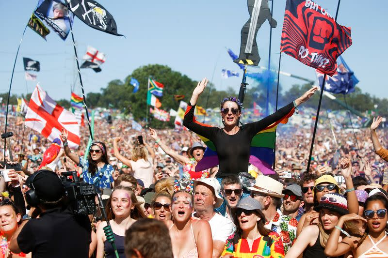 FILE PHOTO: Revellers watch Kylie Minougue perform Pyramid Stage during Glastonbury Festival in Somerset