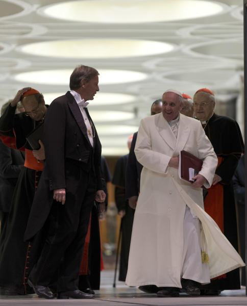 """Pope Francis leaves at the end of the afternoon session of an extraordinary consistory in the Synod hall at the Vatican City, Thursday, Feb. 20, 2014. Cardinals from around the globe have begun discussing some of the most contentious issues in the church amid findings from Vatican-mandated surveys that most Catholics reject church teaching on contraception, divorce and homosexuality. Pope Francis opened the two-day meeting Thursday by urging his cardinals to find """"intelligent, courageous"""" ways to help families under threat today without delving into case-by-case options to get around Catholic doctrine. (AP Photo/Alessandra Tarantino)"""