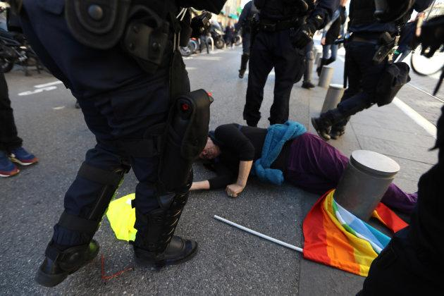 TOPSHOT - French police rush towards Genevieve Legay, an Attac activtist, who collapsed on the ground in Garibaldi Square during a rally by the anti-government 'Yellow Vests' (Gilets jaunes) movement in the city of Nice, southeastern France, on March 23, 2019. - Thousands of police fanned out across central Paris, Toulouse, Bordeaux, Dijon, Rennes and Nice, on March 23, 2019 as 'Yellow vest' demonstrators are expected to hit French city streets again for a 19th consecutive week of nationwide protest against the French President's policies. (Photo by Valery HACHE / AFP) (Photo credit should read VALERY HACHE/AFP/Getty Images)