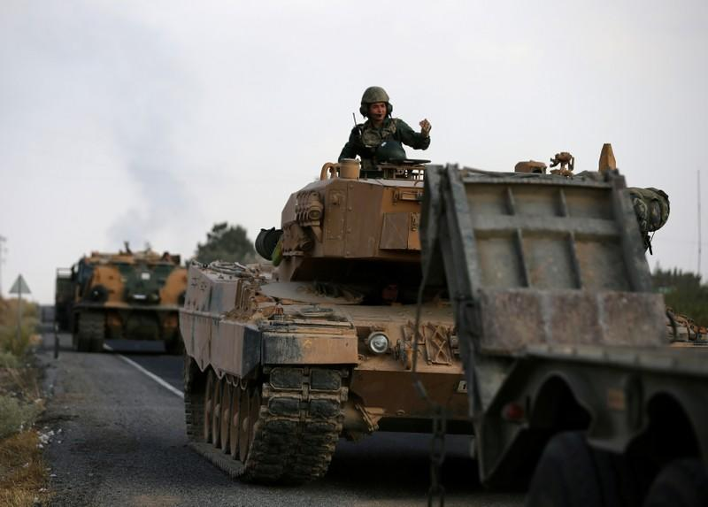 FILE PHOTO: Turkish army vehicles are moving on a road near the Turkish border town of Ceylanpinar