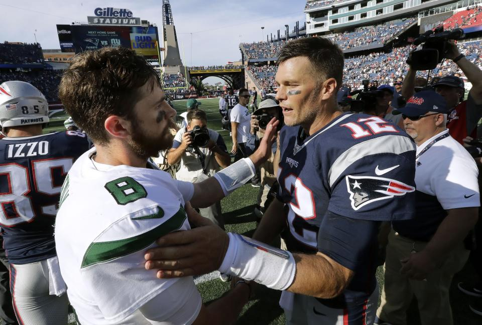 New York Jets quarterback Luke Falk, left, and New England Patriots quarterback Tom Brady speak at midfield after an NFL football game, Sunday, Sept. 22, 2019, in Foxborough, Mass. (AP Photo/Steven Senne)