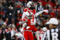 Cincinnati linebacker Perry Young (6) and cornerback Coby Bryant (7) celebrate during the first half of an NCAA college football game against Connecticut, Saturday, Nov. 9, 2019, in Cincinnati. (AP Photo/John Minchillo)