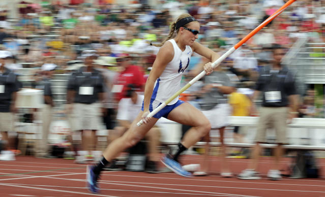 Emory Rains High School's Charlotte Brown competes in the Girls 3A pole vault in the UIL State Track & Field meet, Friday, May 9, 2014, in Austin, Texas. Brown, a pole vaulter who happens to be legally blind, starts on the clap from her coach and counts her steps on her approach. (AP Photo/Eric Gay)