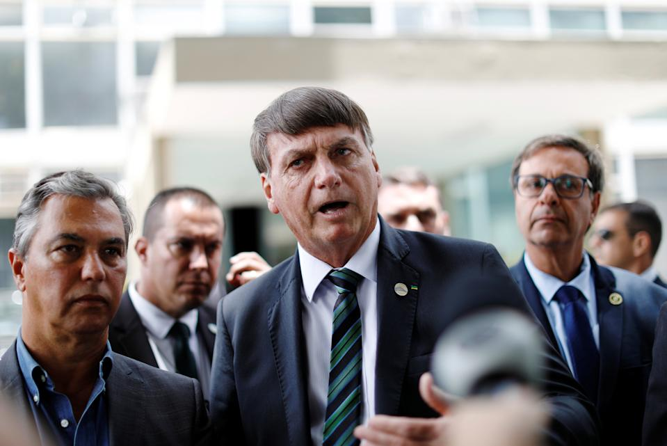 Brazil's President Jair Bolsonaro talks with journalists after a meeting with Economy Minister Paulo Guedes in Brasilia, Brazil January 27, 2021. REUTERS/Ueslei Marcelino