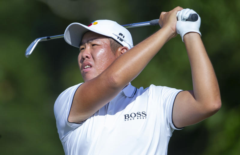 Byeong Hun An follows a shot on the ninth hole during the second round of the Wyndham Championship golf tournament at Sedgefield Country Club in Greensboro, N.C., Friday, Aug. 2, 2019. (H. Scott Hoffmann/News & Record via AP)