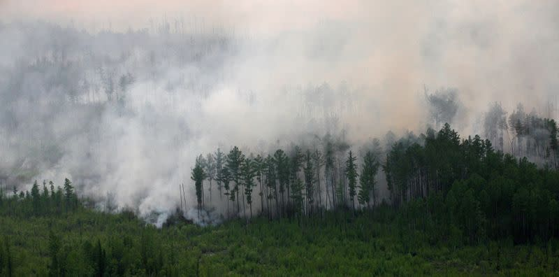 FILE PHOTO: An aerial view shows the Taiga wood burning near Boguchany