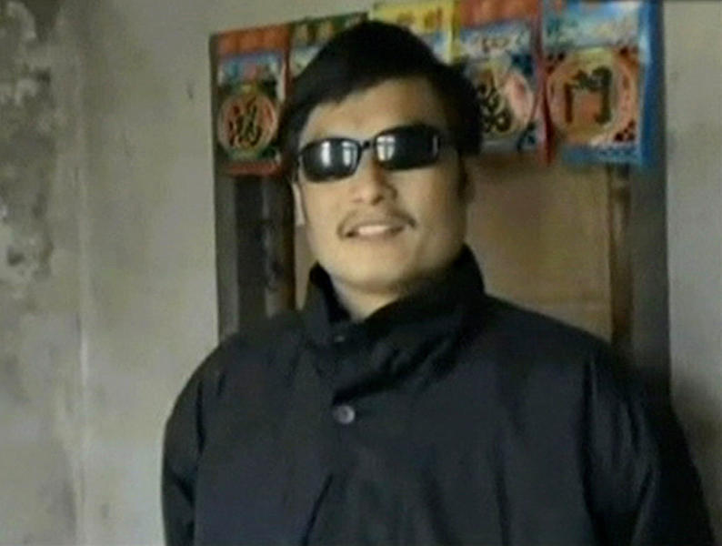 FILE - In this Jan. 2011 file image made from video released on Feb. 10, 2011, by China Aid Association, Chinese activist and lawyer Chen Guangcheng speaks in Dongshigu village, Shandong province, China. Suddenly the guard posts came down and the hired toughs who manned them melted away, restoring an air of freedom this week to the village that authorities turned into a prison to keep the blind activist under house arrest for nearly two years. (AP Photo/China Aid Association, File)