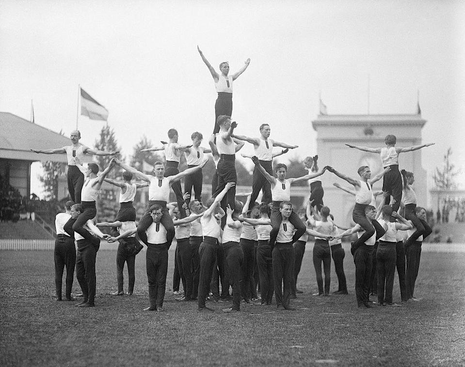 <p>Today's gymnasts do compete in teams, but not like this! Back in the early days of the Olympics, the gymnasts used to do group performances. It was little like cheerleading!</p>