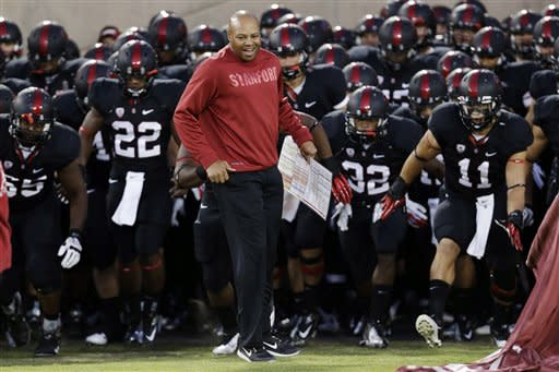 Stanford head coach David Shaw leads his team onto the field at the start of an NCAA college football game against Duke in Stanford, Calif., Saturday, Sept. 8, 2012. (AP Photo/Marcio Jose Sanchez)