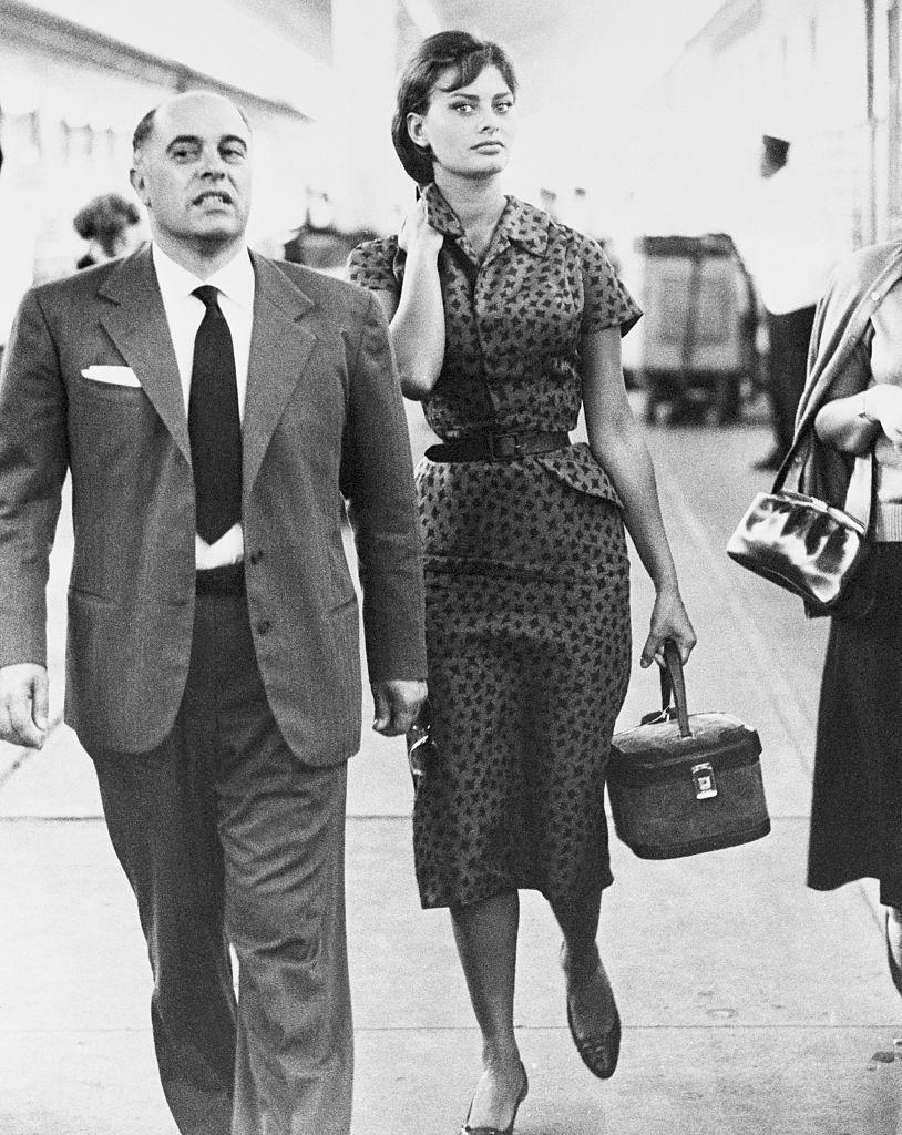 <p>The Italian film star and her new husband, Carlo Ponti, are photographed at the train station in Los Angeles after announcing their secret elopement in Juárez, Mexico in September 1957. </p>