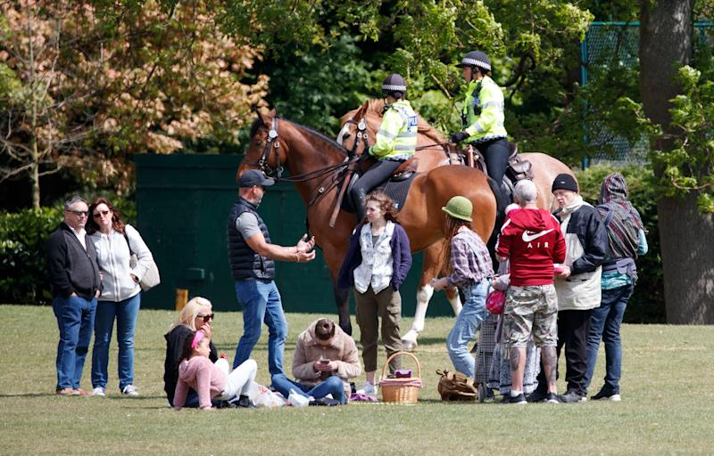 Police monitor a gathering in Endcliffe Park, Sheffield, during the coronavirus pandemic. (Danny Lawson/PA)
