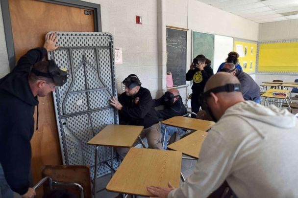 PHOTO: Participants barricade a door of a classroom to block an 'active shooter' during ALICE (Alert, Lockdown, Inform, Counter and Evacuate) training at the Harry S. Truman High School in Levittown, Penn., Nov. 3, 2015. (Jewel Samad/AFP/Getty Images)