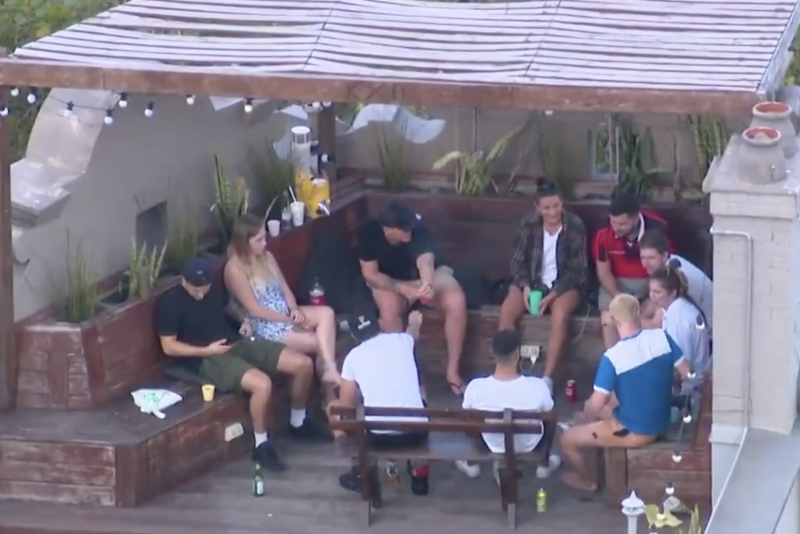 The backpackers were shown socialising in close proximity to each other on the hostel's rooftop. Source: 7 NEWS