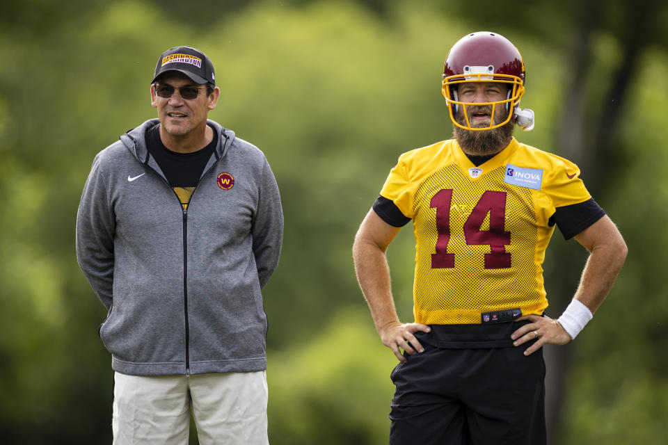 Head coach Ron Rivera of the Washington Football Team and Ryan Fitzpatrick watch drills during an organized team activity on June 2. (Scott Taetsch/Getty Images)