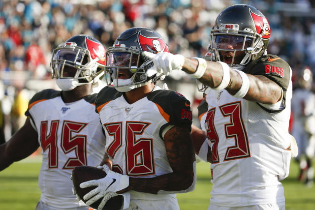Tampa Bay Buccaneers defensive back Sean Murphy-Bunting (26) celebrates his interception against the Jacksonville Jaguars with linebacker Devin White (45) and cornerback Carlton Davis (33) during the second half of an NFL football game, Sunday, Dec. 1, 2019, in Jacksonville, Fla. (AP Photo/Stephen B. Morton)