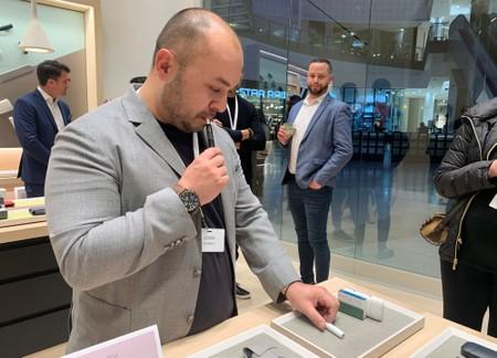 A consumer looks at IQOS heated tobacco products on display as cigarette maker Philip Morris International launches its first flagship boutique store in Sandton