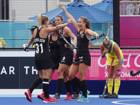 Hockey - Gold Coast 2018 Commonwealth Games - Women's Gold Medal Match - New Zealand v Australia - Gold Coast Hockey Centre - Gold Coast, Australia - April 14, 2018. New Zealand players celebrate winning the gold medal. REUTERS/David Gray