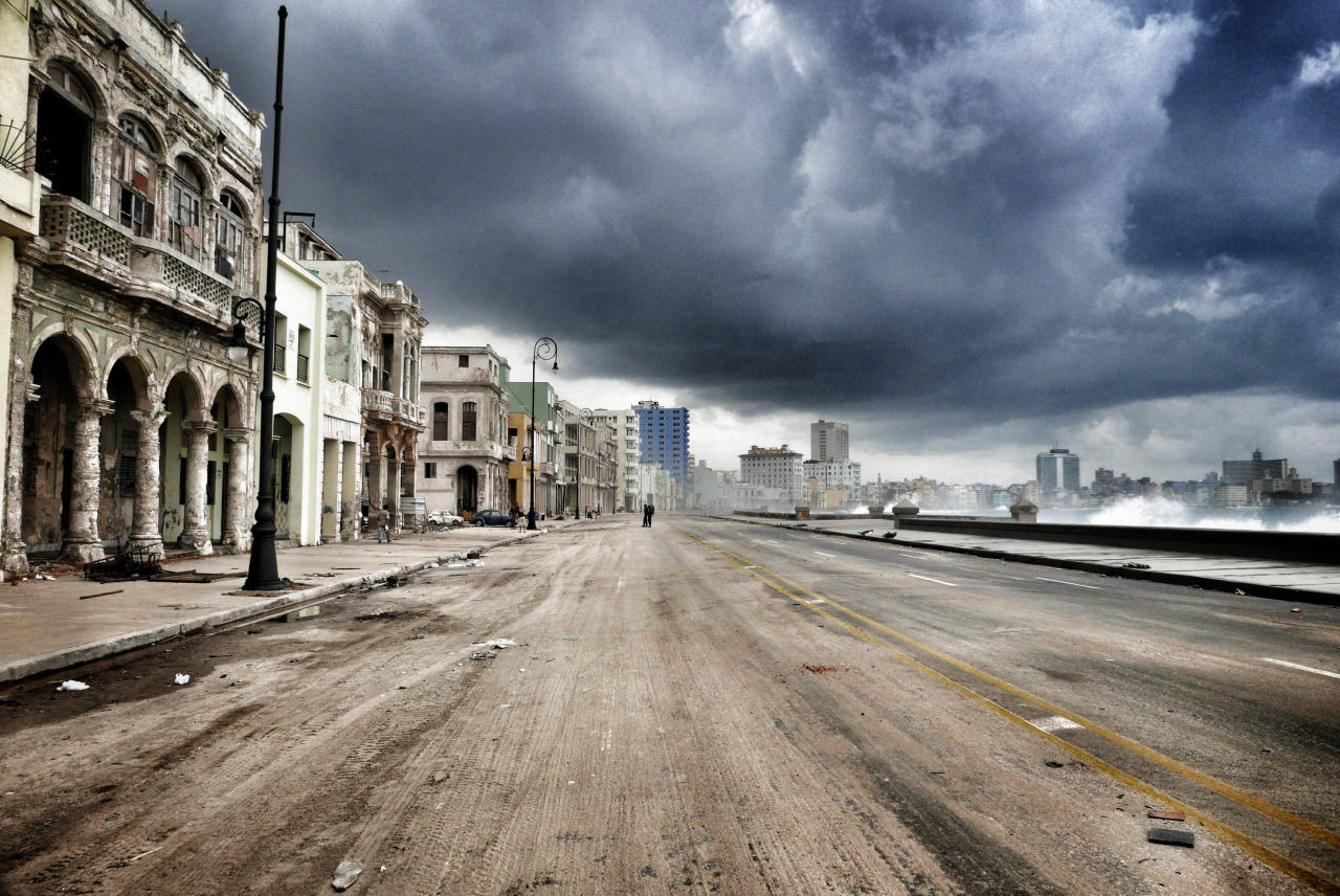 <p>Havana's Malecon waterfront is closed to traffic, three days after Hurricane Irma passed over Cuba, on Sept. 12, 2017, in Havana, Cuba. Hundreds of thousands still have no power as Cuba is recovering from the impact by hurricane Irma. (Photo: Sven Creutzmann/Mambo photo/Getty Images) </p>
