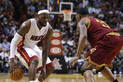 Miami Heat's LeBron James, left, looks to move against Cleveland Cavaliers' Alonzo Gee (33) during the first half of an NBA basketball game, Tuesday, Jan. 24, 2012, in Miami. (AP Photo/Lynne Sladky)