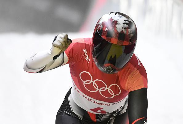 Canada's Elisabeth Vathje pumps her fist after finishing the women's skeleton event at the 2018 Winter Olympics in PyeongChang. (Getty)