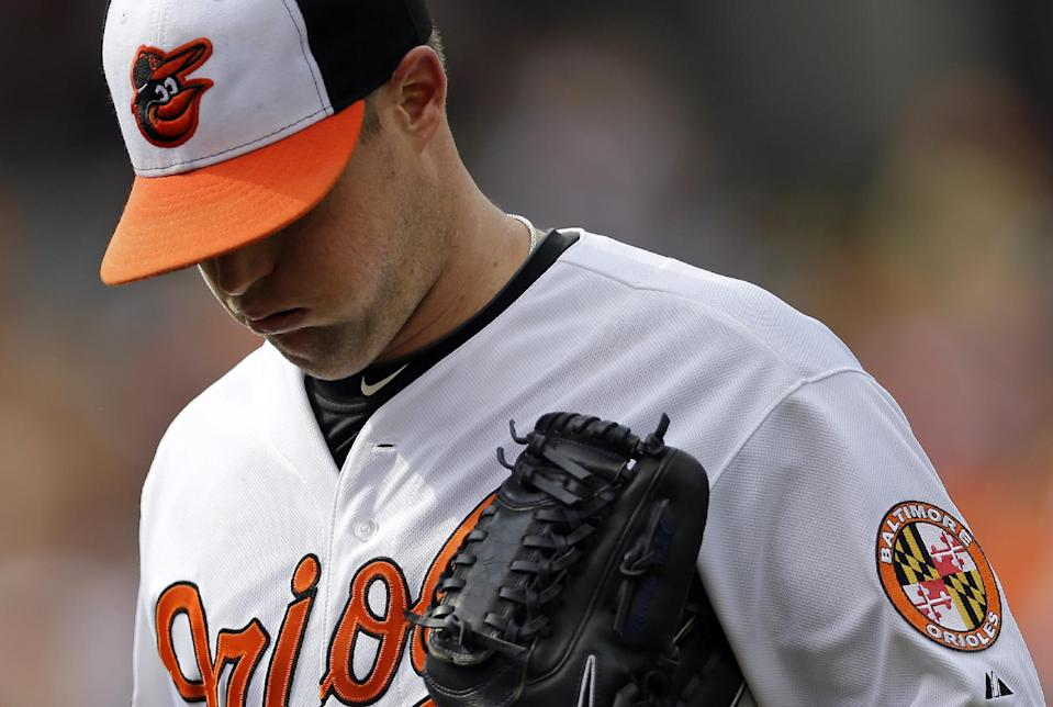 Baltimore Orioles starting pitcher Bud Norris walks off the field after the fourth inning of a baseball game against the Chicago White Sox, Sunday, Sept. 8, 2013, in Baltimore. Norris allowed a run in the fourth, and he was pulled from the game in the fifth. (AP Photo/Patrick Semansky)