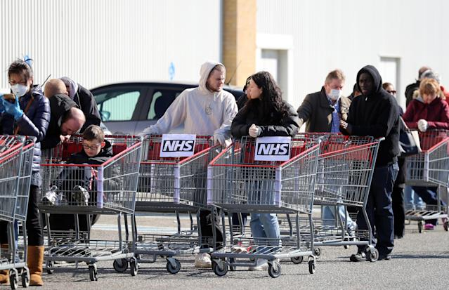 NHS workers queue outside a shop – but many say they are greeted with empty shelves. (Joe Giddens/PA via Getty Images)
