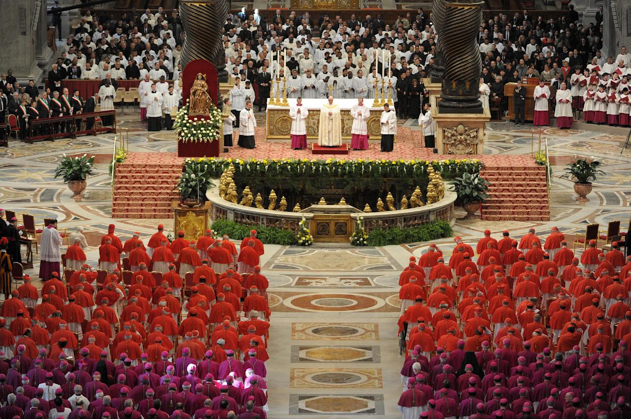 In this photo provided by the Vatican newspaper L'Osservatore Romano, Pope Francis, top center, leads a consistory inside the St. Peter's Basilica at the Vatican, Saturday, Feb. 22, 2014. Retired Pope Benedict XVI, white figure seen at center left, joined Pope Francis at a ceremony Saturday creating the cardinals who will elect their successor in an unprecedented blending of papacies past, present and future. (AP Photo/L'Osservatore Romano, ho)