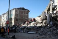 Search and rescue teams work on a collapsed building after an earthquake in Elazig