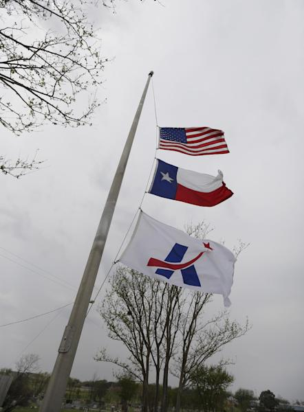 The U.S., Texas and City of Killeen flags fly at at half staff for shooting victims, Thursday, April 3, 2014, in Killeen, Texas. A soldier, Spc. Ivan Lopez, opened fire Wednesday on fellow service members at the Fort Hood military base, killing three people and wounding 16 before committing suicide. (AP Photo/Eric Gay)