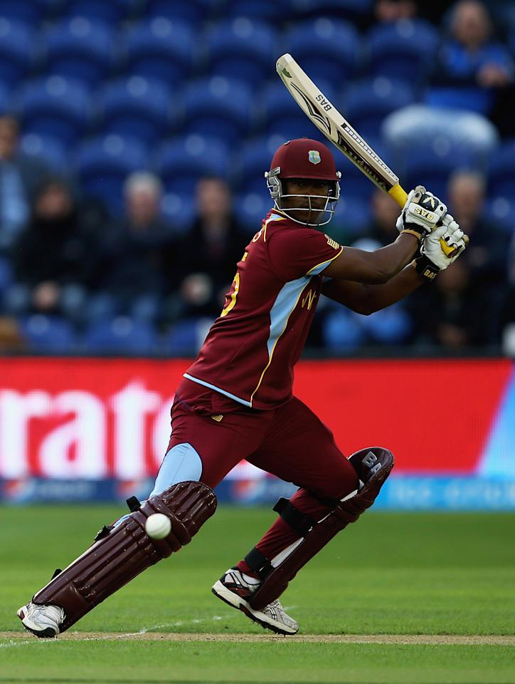CARDIFF, WALES - JUNE 14:  Johnson Charles of the West Indies hits the ball towards the boundary during the ICC Champions Trophy Group B match between West Indies and South Africa at SWALEC Stadium on June 14, 2013 in Cardiff, Wales.  (Photo by Matthew Lewis-ICC/ICC via Getty Images)
