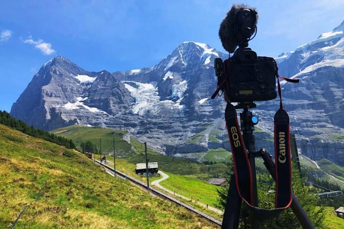 Camera is pictured in front of the Eiger and Moensch mountains in Wengen