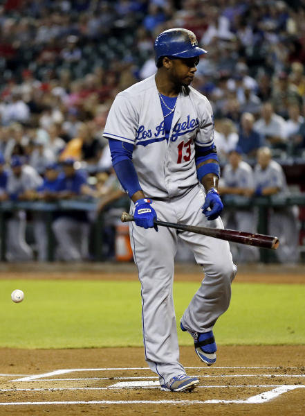 Los Angeles Dodgers' Hanley Ramirez reacts to being hit by Arizona Diamondbacks pitcher Ian Kennedy during the first inning of a baseball game, Tuesday, July 9, 2013, in Phoenix. (AP Photo/Matt York)