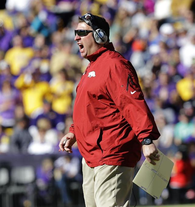 Arkansas head coach Bret Bielema shouts to the officials after a touchdown run was called back in the first half of an NCAA college football game against LSU in Baton Rouge, La., Friday, Nov. 29, 2013. (AP Photo/Bill Haber)