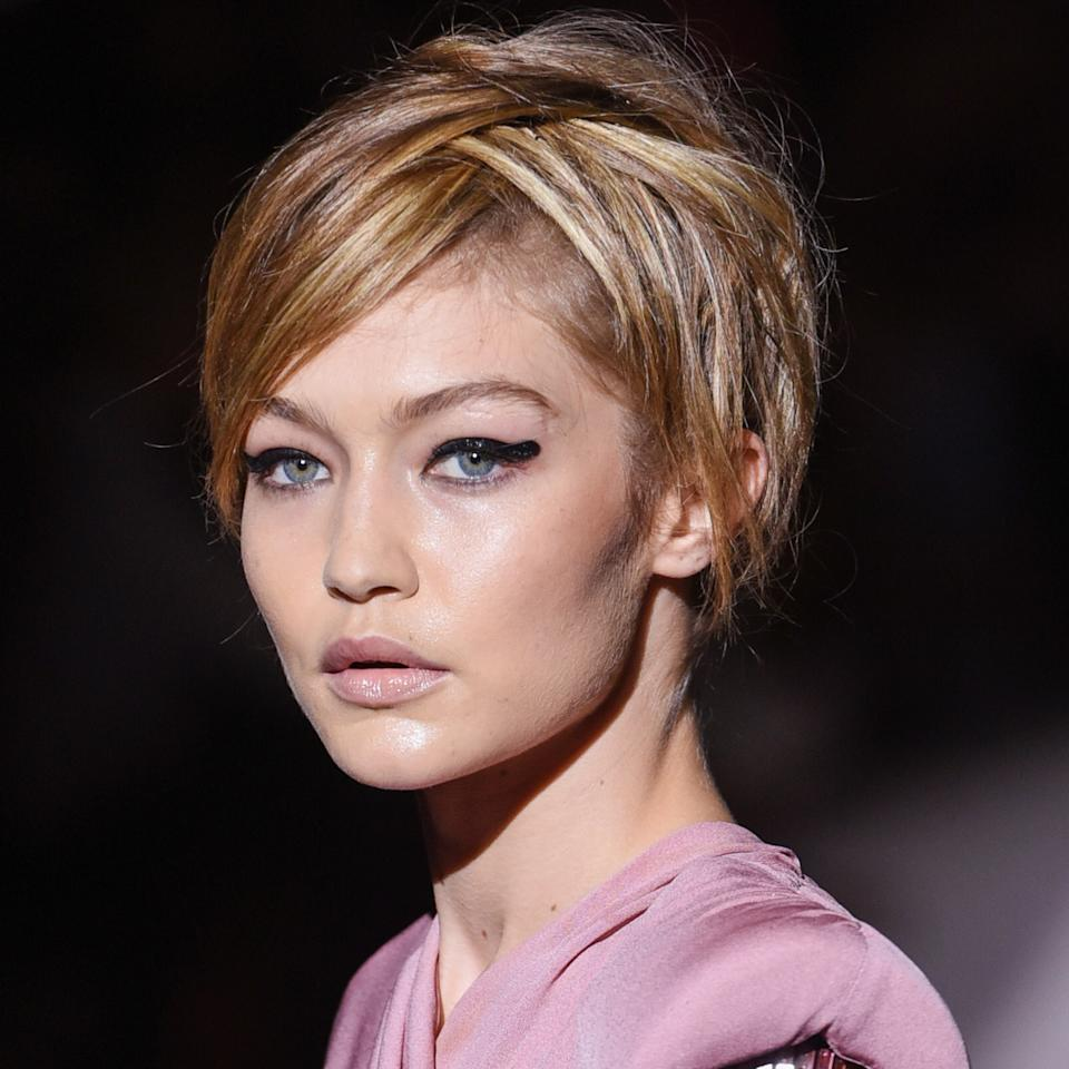 <p><strong>THE LOOK: </strong>Orlando Pita worked with the models' natural hair textures or gave them faux pixie cuts that were short on the sides and long on the top, as seen on Gigi Hadid. Makeup legend Pat McGrath swiped on a thick, smudgy, glittery cat eye on the models' eyes and paired it with a nude lip. </p>