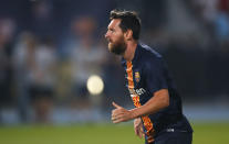 Barcelona's Lionel Messi exercises during warmup before the Spanish Super Cup soccer match between Sevilla and Barcelona in Tangier, Morocco, Sunday, Aug. 12, 2018. (AP Photo/Mosa'ab Elshamy)