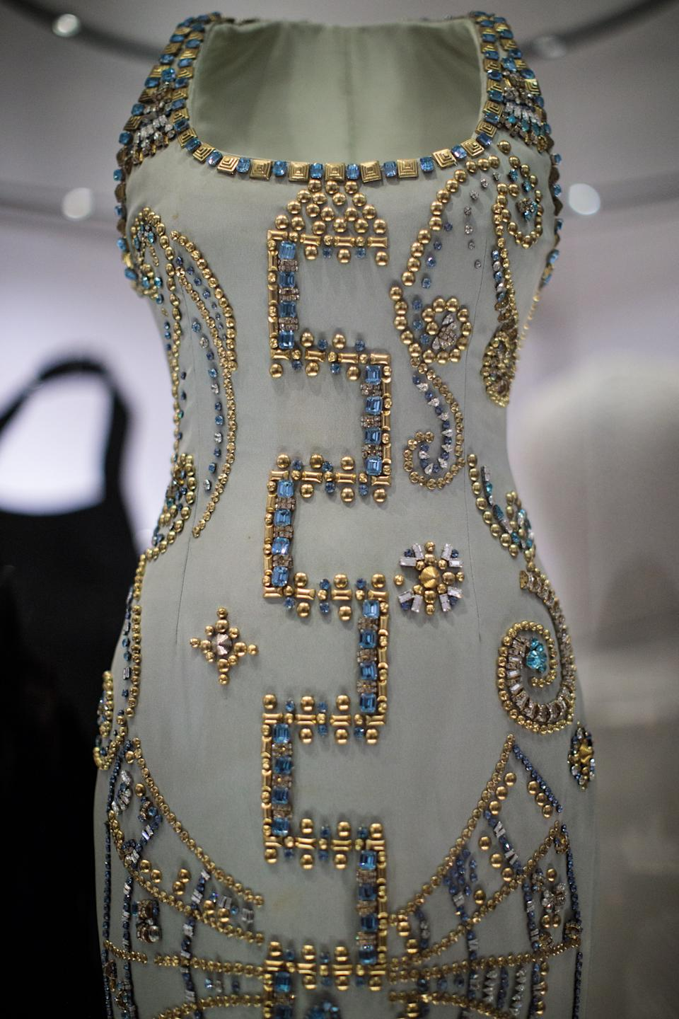 LONDON, ENGLAND - FEBRUARY 22: A 1991 Atelier Versace silk gown worn by Princess Diana at a Harper's Bazaar photoshoot with Patrick Demarchelier on display at a press preview at Kensington Palace on February 22, 2017 in London, England. The exhibition 'Diana: Her Fashion Story', which showcases a number of the Princess' dresses and outfits, opens to the public on February 24 as part of events commemorating the life of Princess Diana to mark the 20th anniversary of her death in Paris on August 31st, 1997.  (Photo by Jack Taylor/Getty Images)