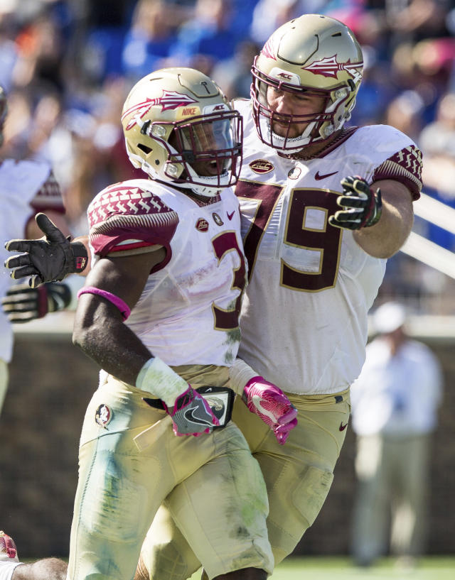 Florida State's Cam Akers (3) celebrates with teammate Josh Ball (79) after scoring a touchdown during the second half of an NCAA college football game against Duke in Durham, N.C., Saturday, Oct. 14, 2017. Florida State beat Duke 17-10. (AP Photo/Ben McKeown)