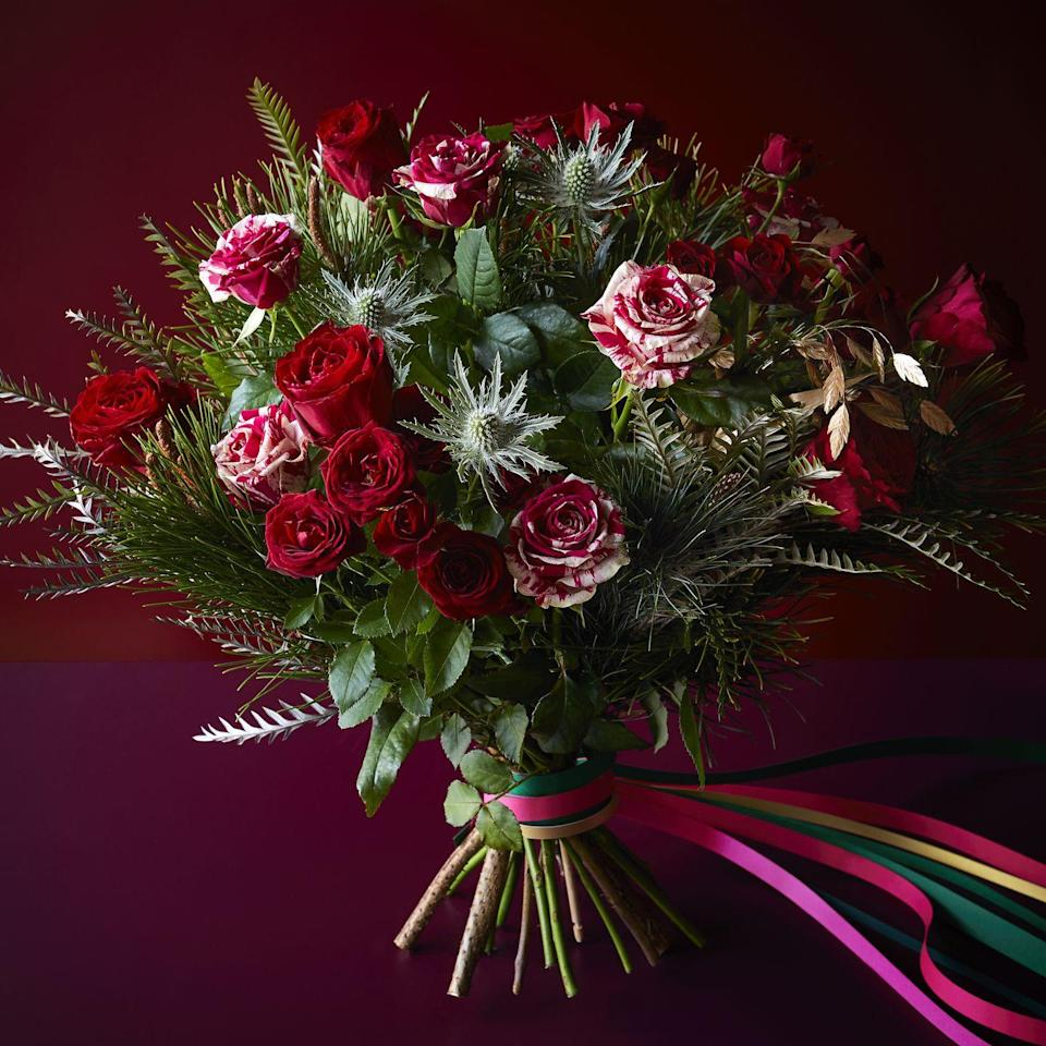 <p>'With the hope that we'll be able to host loved ones this Christmas, many of us will be looking to dress our homes even more beautifully over the festive season,' says Chris Wood, Partner & Flower Product Developer. 'Flowers are the perfect way to add vibrancy. Our Red Christmas bouquet is a classic, with red roses and luscious textural foliage – it also includes these stunning roses with unique red and cream stripes. It would make a wonderful addition to your Christmas decor.'</p>